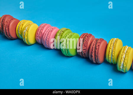 Side view of an excellent macarons or macaroons, sweet meringue-based confection with a ganache, buttercream or jam filling sandwiched between two suc - Stock Photo