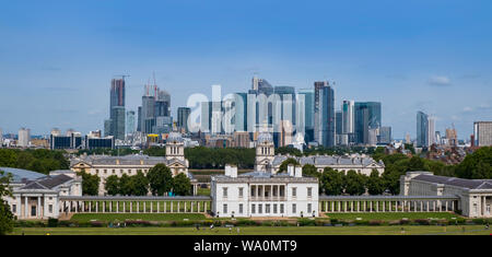 City of London, United Kingdom 6th August 2019: London skyline, Canary Wharf business centre seen from Greenwich. Classical buildings in foreground on - Stock Photo