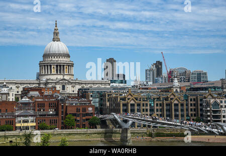 London, UK - July  5, 2019: Skyline of London with the Millennium bridge and St Paul's cathedral in central London on a cloudy day - Stock Photo