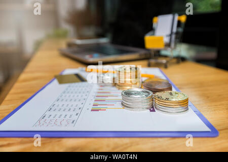 Stack of golden and silver Bitcoins (Cryptocurrency) on paper graph. New Virtual money concept. - Stock Photo