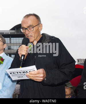 Manchester, UK. 16th Aug, 2019. Danny Boyle film Director reading out the name of Joesph Whitworth, Shot by Infantry at New Cross on the evening of 16th August. © copyright Credit: Della Batchelor/Alamy Live News - Stock Photo