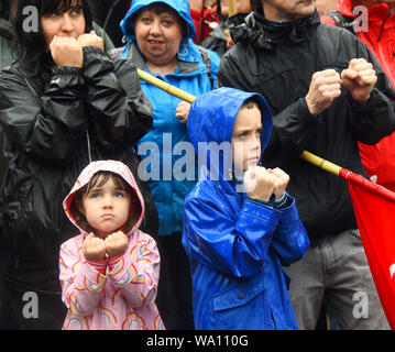 Manchester., UK. 16th Aug, 2019. Neneh aged 4 and brother Liam 8, show solidarity with the crowd at the Peterloo massacre memorial event at Manchester Central. © copyright Credit: Della Batchelor/Alamy Live News - Stock Photo