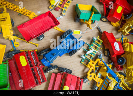 Old diecast farm vehicles for sale in a box. - Stock Photo