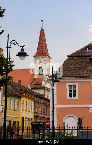 Sibiu, Romania - August 23rd, 2018: A street in the old city of Sibiu, Romania, under a clear sky, at summer time - Stock Photo