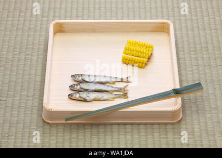 Hassun, assorted tidbits for Japanese tea ceremony cuisine on tatami mat. - Stock Photo