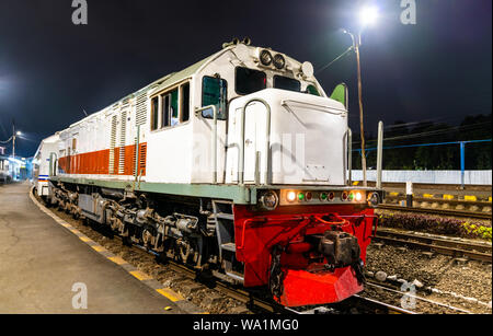 Passenger train at Malang station in Indonesia - Stock Photo