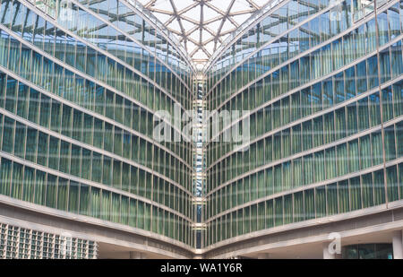 Milan, Italy October 13 - 2017 Modern building glass design, modern office or building with business people in Milan, business district. - Stock Photo
