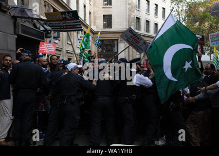 London, UK. 15th August, 2019. Kashmir protesters in front of India House in London, after its government scrapped the special constitutional status of Kashmir, clashing with police ofificers. Credit: Joe Kuis / Alamy News - Stock Photo