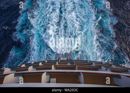 View of the stern of a ship and the wake left by the propellers, Mediterranean sea - Stock Photo