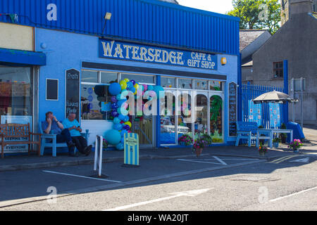 8 August 2019 A small general store with goods displayed outdoors overlooking the harbour in Ardglass County Down Northern Ireland during the village - Stock Photo