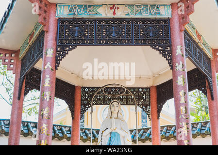 Ho Chi Minh City, Vietnam: Mother Mary statue in a Chinese style arbor on the territory of Cha Tam Church (St. Francis Xavier Parish Church). - Stock Photo
