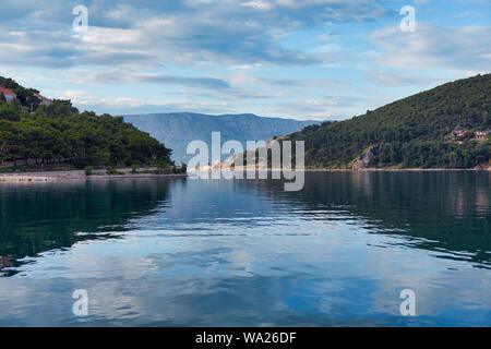 A quiet beach in Croatia. Pucisca, a view of the continental part of Croatia - Stock Photo