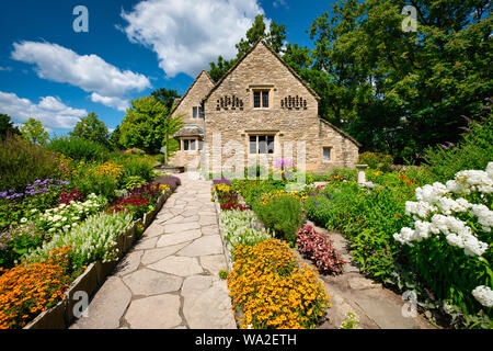 Cotswold Cottage and its surrounding English gardens, located in Greenfield Village at the Henry Ford Museum located in Dearborn, Michigan, USA - Stock Photo
