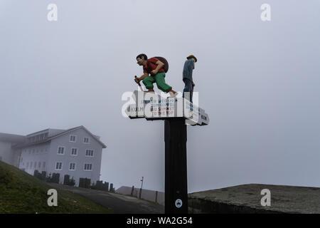 Sign for hikers at Rigi Kulm, Switzerland - Stock Photo