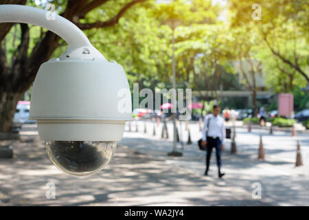 Security camera CCTV monitoring on the public area. While people walking beside walkway in city. - Stock Photo