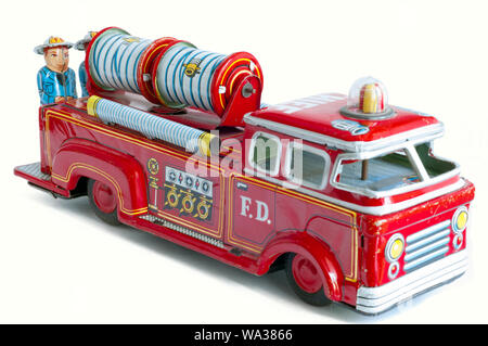 A beautiful  red vintage firetruck tin toy - Stock Photo
