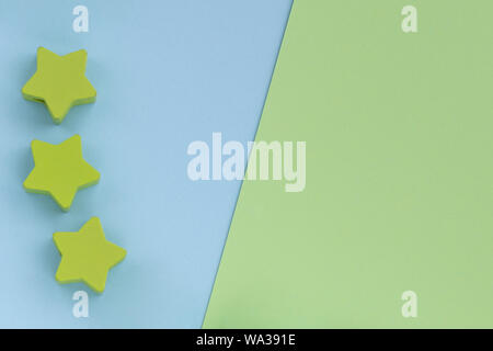 Kids toys on pastel blue green paper background. Top view on children's educational games. Wooden stars. Flat lay, copy space. - Stock Photo