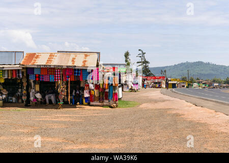 Curio shacks selling souvenirs and gifts lining the A104 in the Rift Valley, Kenya - Stock Photo