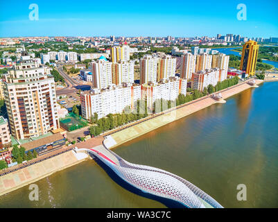NUR-SULTAN, KAZAKHSTAN - July 30, 2019: Beautiful panoramic aerial drone view to Ishim River Embankment and Nursultan (Astana) city center with skyscr - Stock Photo