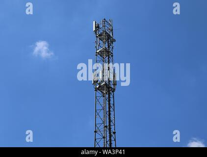 Big telecommunication antenna in a detailed close up view found on an agricultural field - Stock Photo