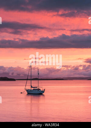 Boat on stunning sunset over Loch Etive at Connel, nr Oban, Scotland - Stock Photo