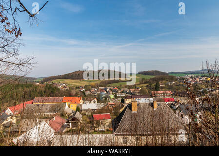 Bouzov village with beatiful landscape scenery around consist from mixture of meadows, fields and small hills covered by forest in Czech republic duri - Stock Photo
