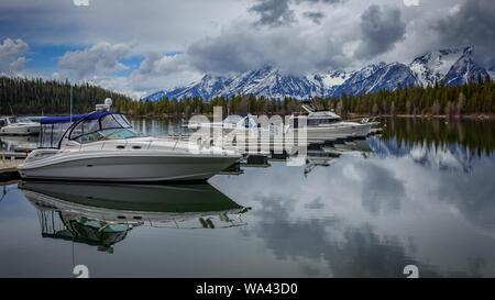 Boats rest in the docks of Jackson Lake, Grand Teton National Park, Wyoming, USA - Stock Photo