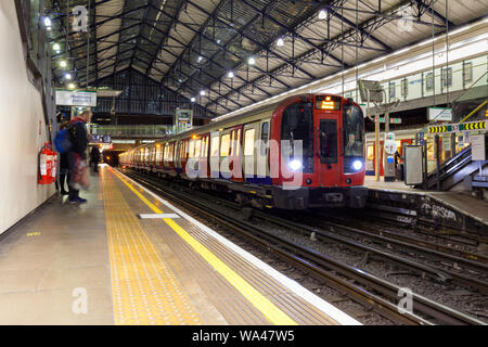 Earls Court London Underground station, Upminster bound district line train formed of Bombardier built S-stock - Stock Photo