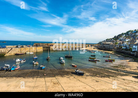 Small fishing boats in Mousehole harbour Cornwall England GB UK EU Europe - Stock Photo