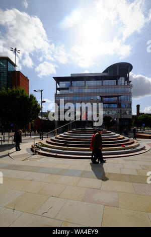 Portrait view of Peterloo Memorial Manchester in blue skies and sunshine with people interacting. - Stock Photo