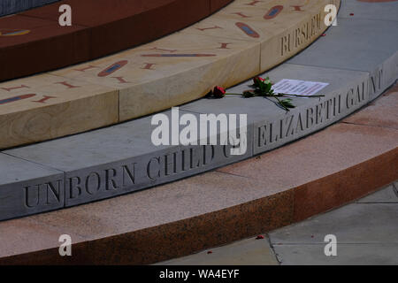 Close up view of part of Peterloo Memorial Manchester featuring inscription commemorating unborn child of Elizabeth Gaunt and roses - Stock Photo