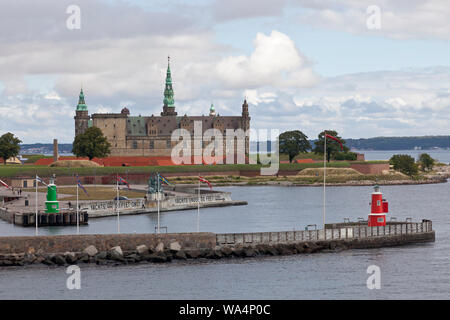Kronborg Castle on the Kronborg point at the Sound Øresund, entrance to Elsinore, Helsingør, Harbour. Sweden in distance. A summer morning. - Stock Photo