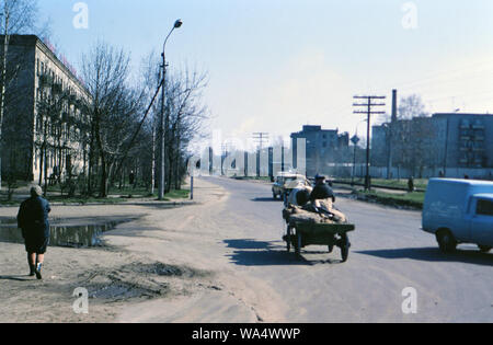 Russian man driving a cart drawn by an animal, horse or mule - 1970s Russia - Stock Photo