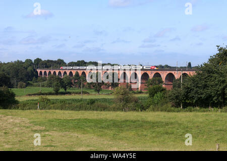 Virgin Trains class 390 Pendolino train crossing Twemlow Viaduct, Holmes Chapel, Cheshire on the west coast mainline - Stock Photo