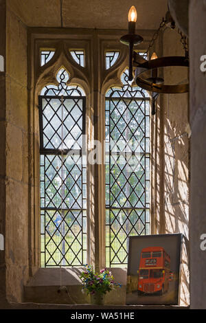 Imber, Wiltshire, UK. 17th Aug 2019. Transported back to bygone days! Thousands of visitors make the most of the opportunity to discover the lost village of Imber and explore Imber Church on Salisbury Plain on a special Open Day, Imberbus event.  The civilian population of Imber village was evicted in 1943 during the second World War and remains an uninhabited village, used by British Army as a training ground. Inside St Giles Church at Imber. Credit: Carolyn Jenkins/Alamy Live News - Stock Photo
