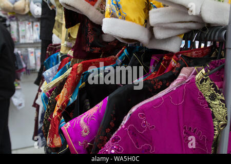Buenos Aires, Argentina. Some kimonos and other Chinese clothing in a Chinese Bazaar, in the Chinatown of Belgrano. - Stock Photo