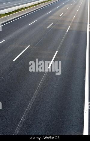 Empty 4-lanes highway - Stock Photo