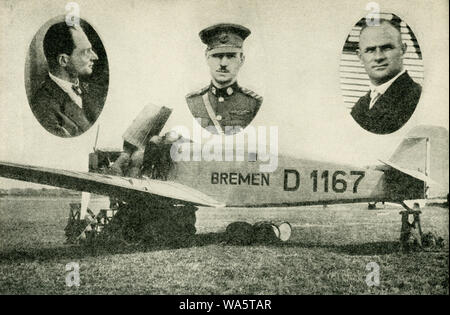 This photo dates to the 1920s. The caption reads: First to make the westward flight over the North Atlantic. These three intrepid airmen were the first to the hop from Europe to America. In the center is Major Fitzmaurice, of the Irish Free State Air Force; at the left is Baron von Huenefeld, German leader of the flight; at the right is Captain Koehl, chief pilot, and a bombing pilot with the German forces during the war, They hopped off from Dublin, Ireland, April 12, and brought the Bremen down safely on Greenly Island, in the Strait of Belle Isle, April 13, 1928. - Stock Photo