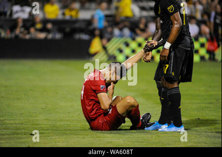 Saturday, August 17, 2019: Toronto FC defender Omar Gonzalez (44) is helped up in the second half of the match between Toronto FC and Columbus Crew SC at MAPFRE Stadium, in Columbus OH. Mandatory Photo Credit: Dorn Byg/Cal Sport Media. Toronto FC 2 - Columbus Crew SC 2 at the end of the first half. - Stock Photo