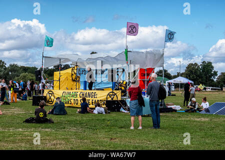 """UK, London, Blackheath Common, 17-18th August 2019. An Extinction Rebellion event in South East London this weekend raises awareness of increasing Global climate change. Activists have planned activities on Blackheath Common to protest council and government investment in the fossil fuel industry and its effects on life on land & in the oceans. The two-day festival has included discussions, speakers, live band and entertainment. A free food (with voluntary donation) stall is serving Vegan food to the crowd. On Sunday (18th August) there will be a """"new black death procession,"""" where protesters - Stock Photo"""
