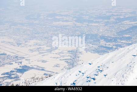 The view from the summit of Untersberg mountain in Austria.  In the background can be seen the city of Salzburg. - Stock Photo