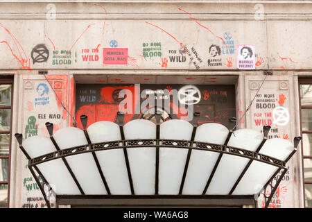 Embassy of Brazil, London, UK. 17th Aug, 2019. Red paint, graffiti and posters above the entrance to the Brazilian Embassy, Cockspur Street. On the 13th August the embassy was targeted by activists from Extinction Rebellion group. Penelope Barritt/Alamy Live News - Stock Photo