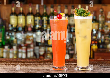 Two alcoholic refreshing drinks on a summer day. Alcoholic cocktails based on rum, vermouth and fruit juices. Space for text - Stock Photo