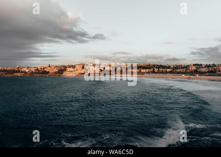 The first rays of morning sun hit the South Bondi Headland on a cold winter morning.