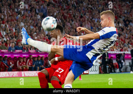 Maximilian MITTELSTAEDT (# 17, B) clarifies to David ALABA (# 27, M). Soccer, FC Bayern Munich (M) - Hertha BSC Berlin (B) 2: 2, Bundesliga, 1.matchday, season 2019/2020, on 16/08/2019 in Muenchen / ALLIANZARENA / Germany. Editorial Note: DFL regulations prohibit any use of photographs as image sequences and / or quasi-video. ¬   usage worldwide - Stock Photo