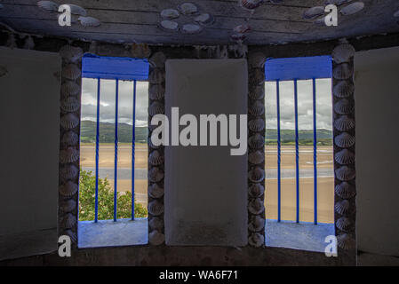 Penrhyndeudraeth, Wales, UK - Aug 15, 2019: View on the Afon Dwyryd estuary taken from blue fringed windows of a Portmeirion grotto - Stock Photo