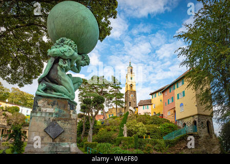 Penrhyndeudraeth, Wales, UK - Aug 15, 2019: View on the Portmeirion village and an Hercules statue in the foreground with no people - Stock Photo