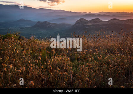This is a picture in Corisca, my home, I took during the golden hours/blue hour transition.I tried to capture the most colourful light. - Stock Photo