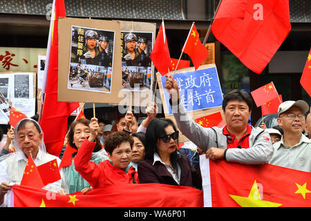 London, UK. 18 August 2019. Hundreds of Pro-China and Pro-HK united 'We love China - We Love HK' to supports HK police assembly in London Chinatown march to Trafalgar Square anti-violence and restore peace in HK, singing China national anthem along the way and all the criminal must be punished by the rule of law. In fact, Since the HK protests and the western propaganda media backfire each day China growing supporters from all world and oversea born Chineseand your self consciousness. Credit: Picture Capital/Alamy Live News - Stock Photo