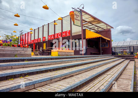Place du Marche public market building and Havre aux Glaces ice cream shop in Montreal, Quebec, Canada. - Stock Photo